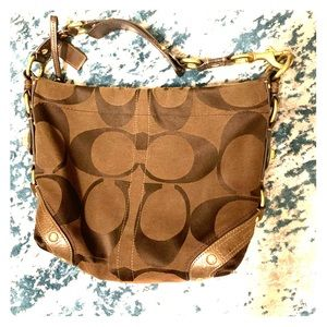 Medium sized brown gently used Coach bag